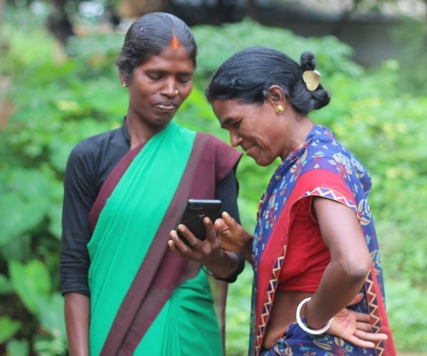 Reach Mobile - A recipient of free connectivity, Mary watches farming videos on YouTube for her crops.